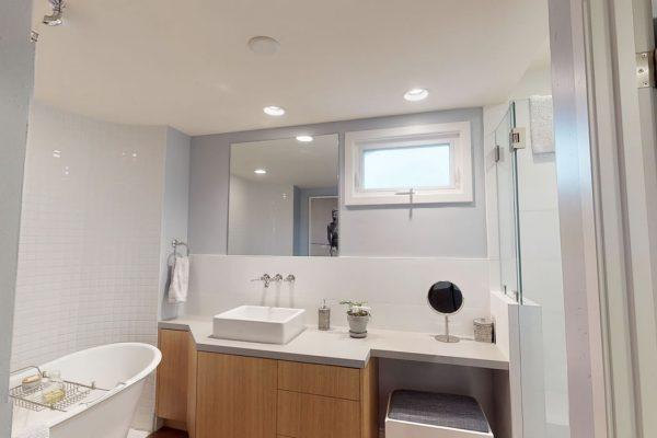 1st floor, full bath: sink, tub and mirror.