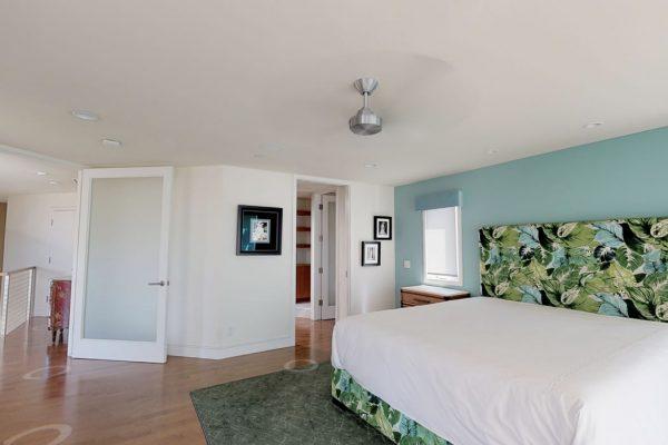 Master bedroom, looking out. Bed, door to bathroom