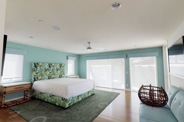 Master bedroom, 2nd floor: bed, couch and night stands.