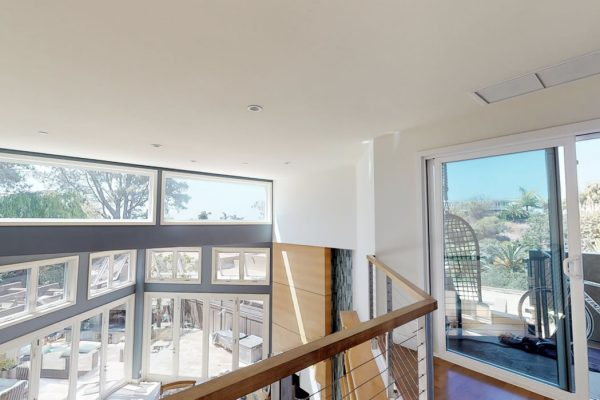 View of from 2nd floor down to living area and patio.