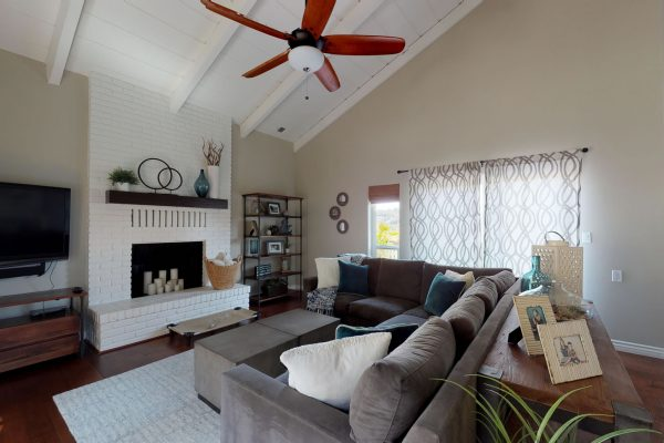 Living room with ceiling fan.