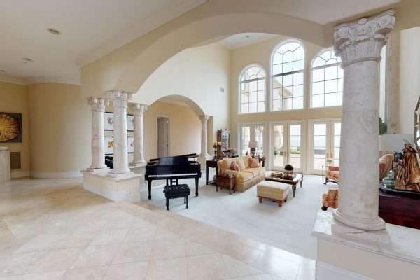 Home interior with huge windows and black piano