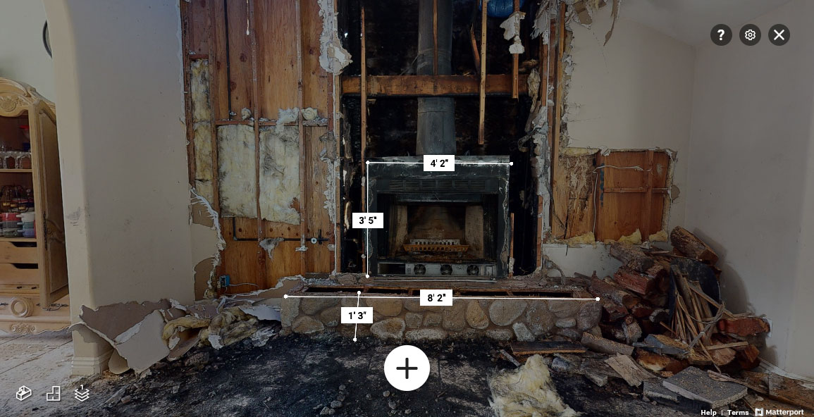 Annotated image showing interior fire damage.