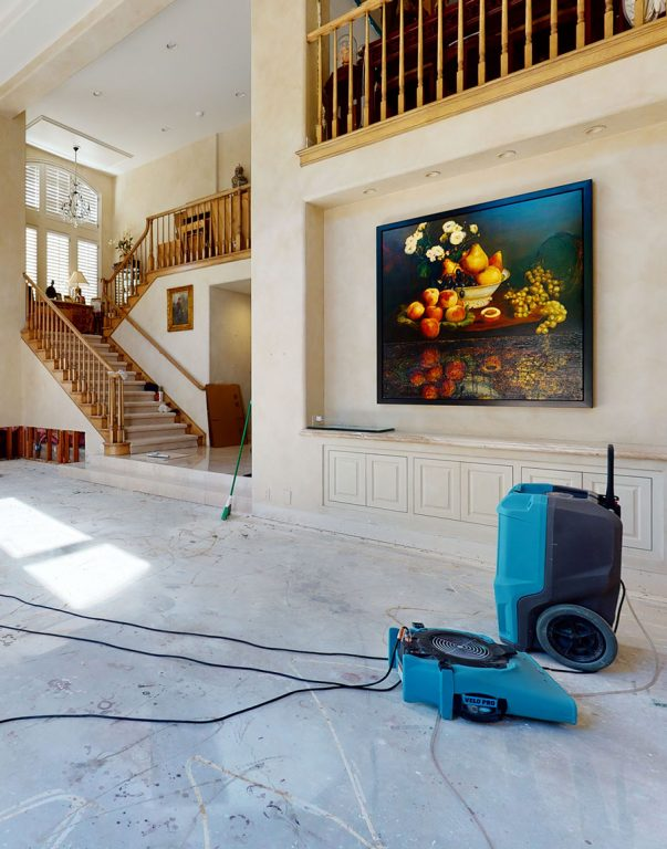 A living room with repair equipment in it.